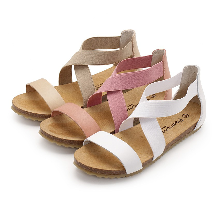 Leather sandals with crossover elastic straps