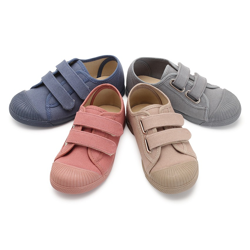 Canvas trainers rubber toes two loop fasteners straps
